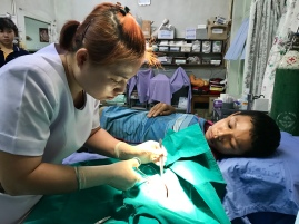 SN Kurn suturing a wound