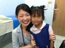 Dr Vivien with a young patient