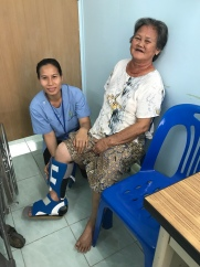 Saichon taking care of a patient