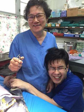 "Dr Felicia shows Dr Chang Noi the ""old-school"" way to remove a foreign body from the ear"