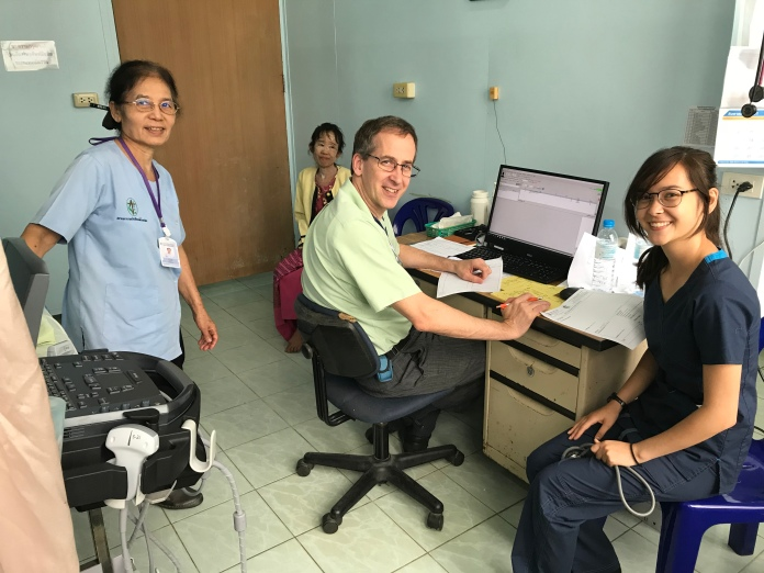 Dr Paul Bunge with his daughter Erika seeing patients with Ba Dora's help in translation