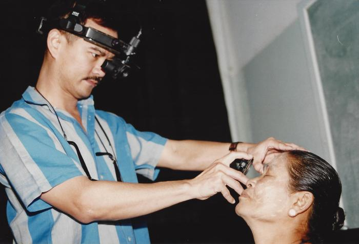 Dr. Veeraphan evaluating a patient at KRCH
