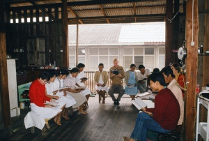Morning worship in the wooden building used as temporary outpatient examining area as well as lab and pharmacy.