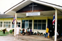 Nurse Sabaithip at hospital entrance, 1980's or early 1990's