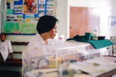 Lea Lindero caring for a baby in the incubator