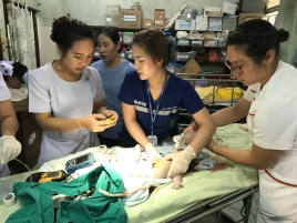 AN Nit with SN Ying and visiting SN Hannah resuscitating an infant